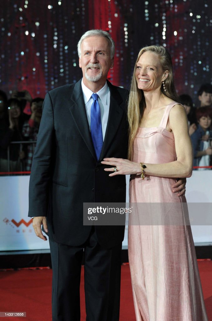 Canadian film director <a gi-track='captionPersonalityLinkClicked' href=/galleries/search?phrase=James+Cameron&family=editorial&specificpeople=206399 ng-click='$event.stopPropagation()'>James Cameron</a> and his wife <a gi-track='captionPersonalityLinkClicked' href=/galleries/search?phrase=Suzy+Amis&family=editorial&specificpeople=790397 ng-click='$event.stopPropagation()'>Suzy Amis</a> arrive for the red carpet of 2nd Beijing International Film Festival at China National Convention Center on April 23, 2012 in Beijing, China.
