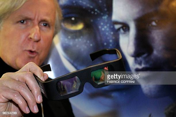 Canadian film director James Cameron shows 3D glasses prior to a show of his movie'Avatar' on the side line of the World Economic Forum annual...