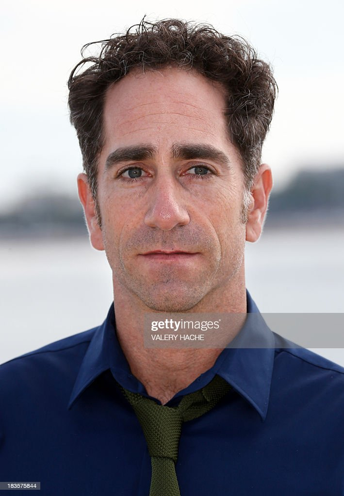 Canadian film director JB Sugar poses during a photocall for a TV show 'Bitten' as part of the Mipcom international audiovisual trade show at the Palais des Festivals, in Cannes, southeastern France, on October 7, 2013.