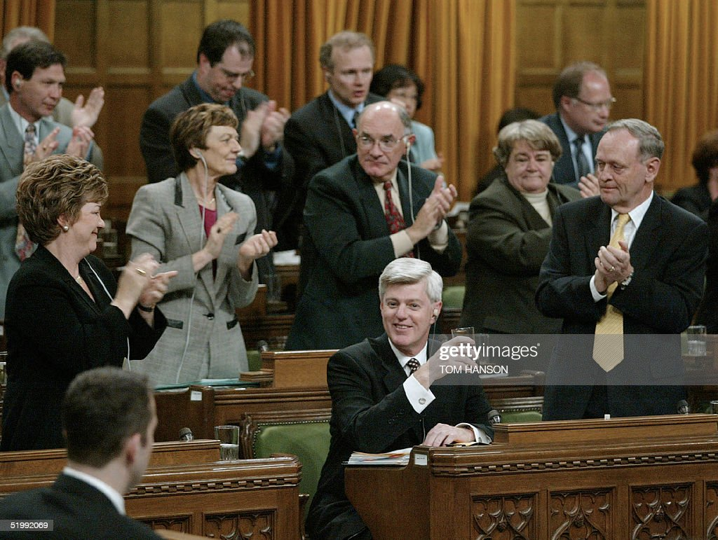 Canadian Finance Minister John Manley is given a standing Ovation from caucus members 03 June 2002 during Question Period in the House of Commons in...
