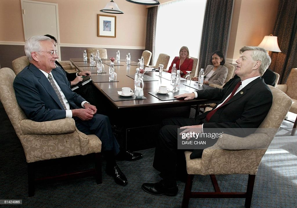 Canadian Finance Minister John Manley shares a laugh with US Secretary of the Treasury Paul O'Neill 14 June 2002 during a bilateral meeting prior the...