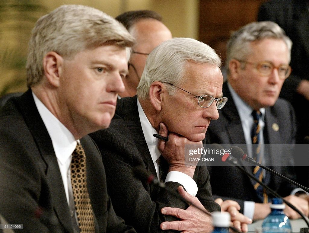 Canadian Finance Minister John Manley US Secretary of the Treasury Paul O'Neill and Italian Finance Minister Giulio Tremonti listens to a reporter's...