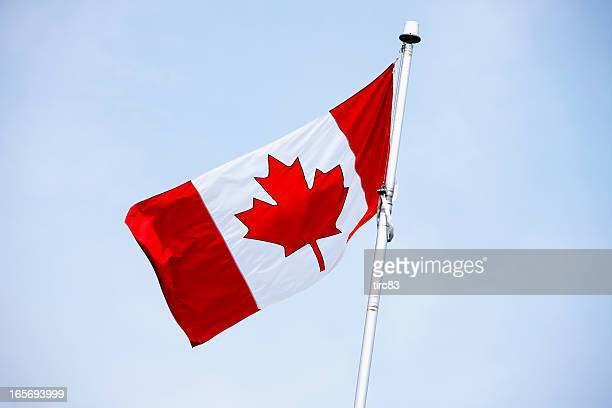 Canadian flag blue sky
