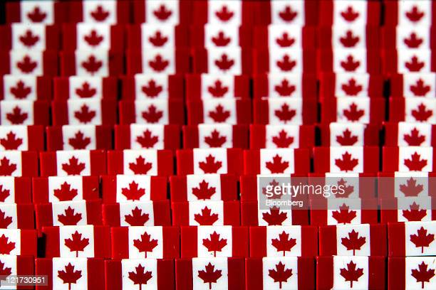 Canadian flag pins are arranged for a photograph in Toronto Ontario Canada on Thursday Aug 18 2011 The Canadian dollar advanced against most of its...