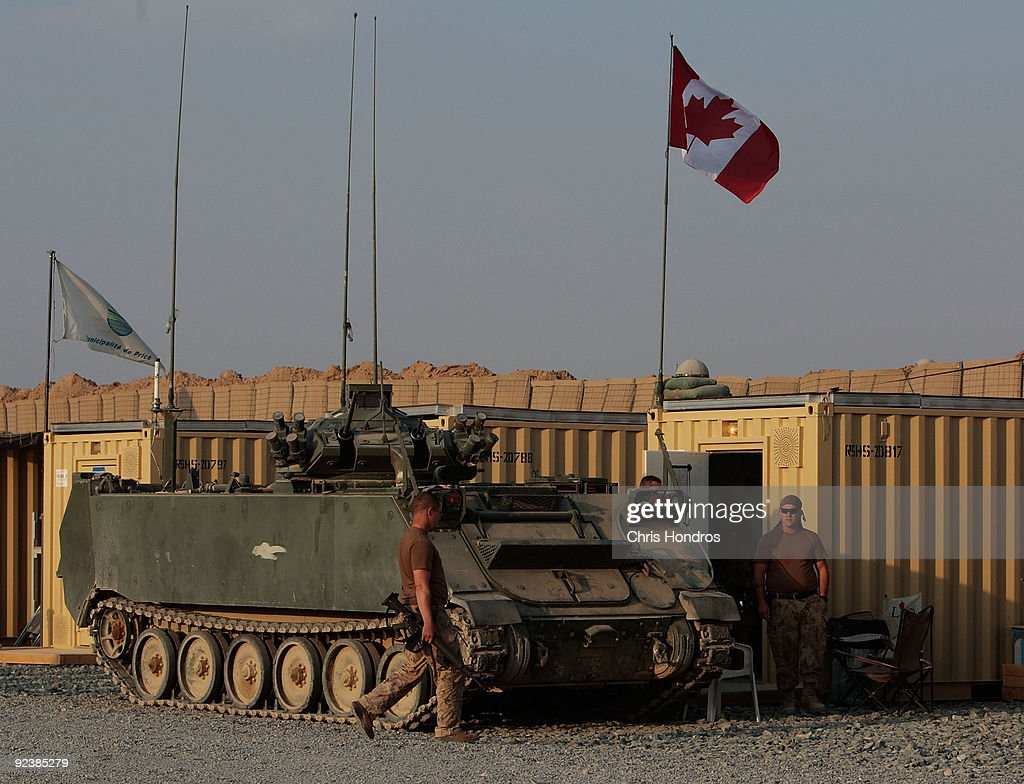 Canadian forces stand outside their armored sleeping containers October 27, 2009 at Forward Operating Base Wilson in Kandahar Province, Afghanistan. According to reports, U.S. President Barack Obama is still mulling a decision whether to send more troops to Afghanistan and has said he won't be rushed into making the decision.