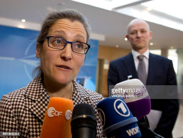 Canadian Foreign Minister Chrystia Freeland speaks to the media as she arrives for a meeting of NATO foreign ministers at the NATO headquarters in...