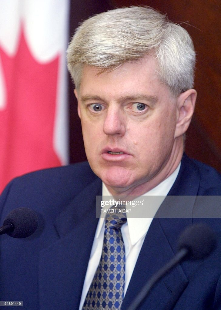 Canadian Foreign Minister John Manley listens on at Beirut's Seraille or government house 30 October 2001 after his meeting with Lebanese Prime...