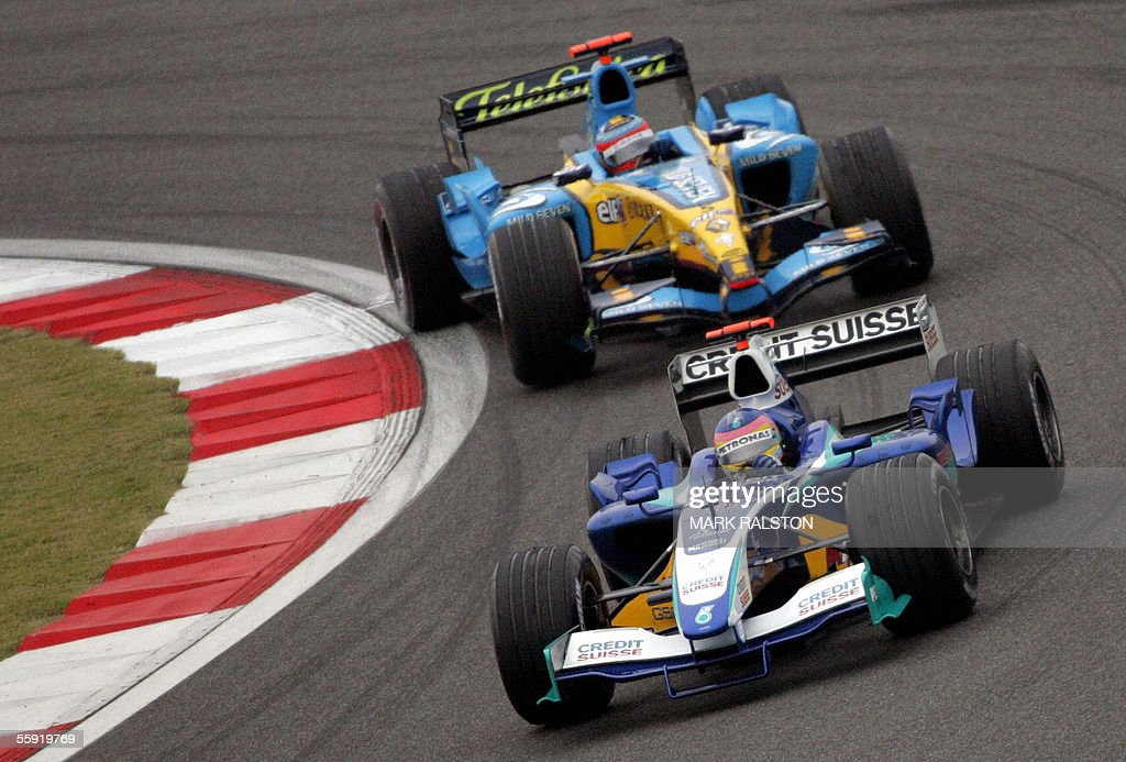 Canadian formula one driver Jacques Villeneuve in a Sauber Petronas is chased by 2005 World Champion Fernando Alonso from Spain in a Renault during...