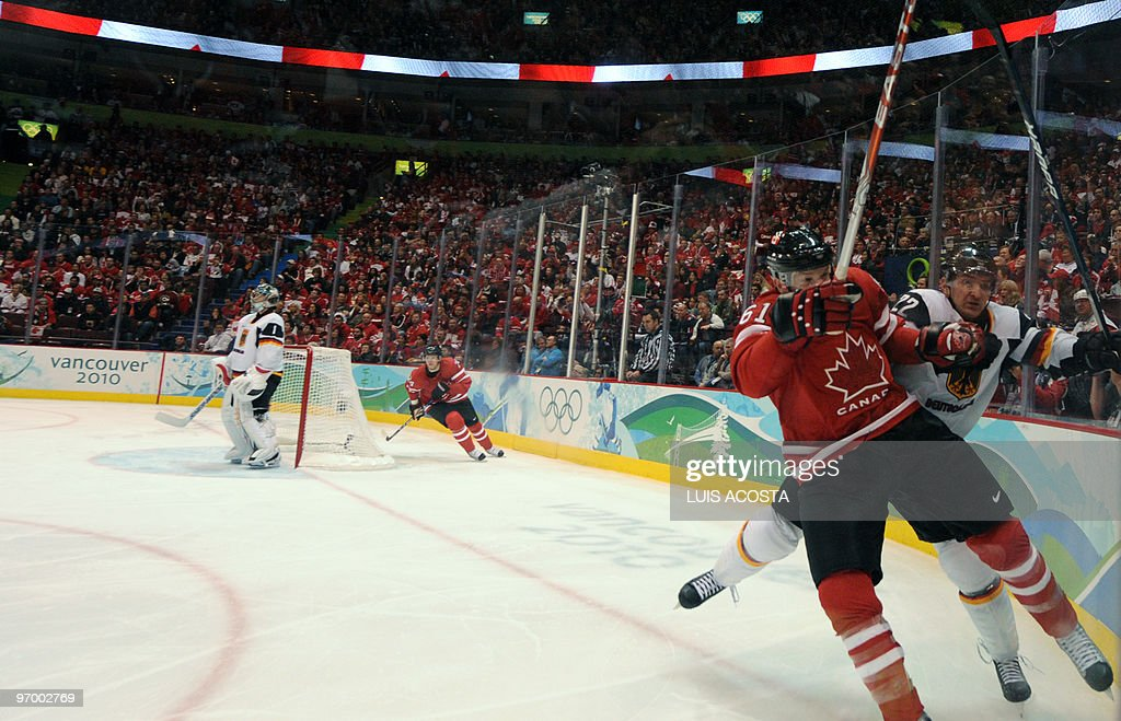 Canadian forward Rick Nash vies for the puck against Germany's defence Michael Bakos during the Men's Ice Hockey playoff game between Canada and...