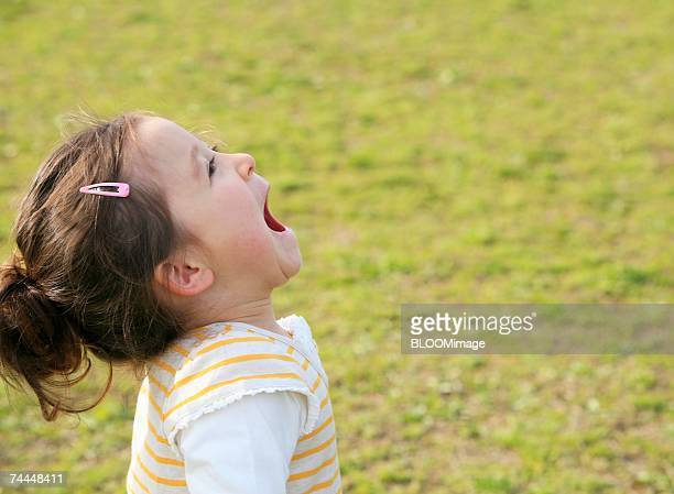 Canadian girl crying to the sky with smiling