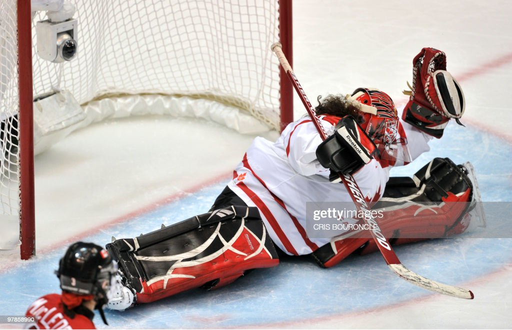 Canadian goalkeeper Shannon Szabados (1) blocks the bet during the Women's Gold Medal Hockey game between USA and Canada at the Canada Hockey Place during the XXI Winter Olympic Games in Vancouver, Canada on February 25, 2010.