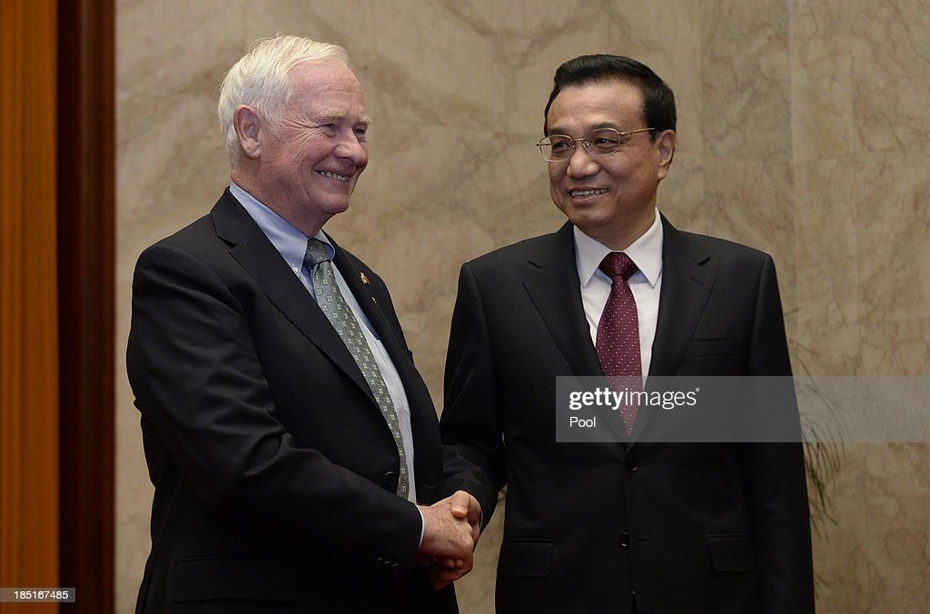 Canadian Governor General David Johnston (L) shakes hands with Chinese Premier <a gi-track='captionPersonalityLinkClicked' href=/galleries/search?phrase=Li+Keqiang&family=editorial&specificpeople=2481781 ng-click='$event.stopPropagation()'>Li Keqiang</a> (R) before a meeting at the Great Hall of the People on October 18, 2013 in Beijing, China. David Johnston is visiting China focusing on Canada-Sino relations and is expected to speak at the Canada China Business Council's annual meeting.