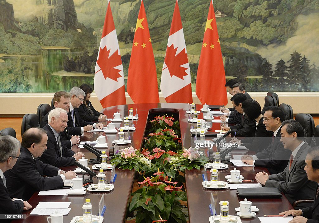 Canadian Governor General David Johnston (3rd L) talks with Chinese Premier Li Keqiang (3rd R) during a meeting at the Great Hall of the People on October 18, 2013 in Beijing, China. David Johnston is visiting China focusing on Canada-Sino relations and is expected to speak at the Canada China Business Council's annual meeting.