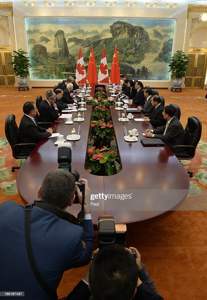 Canadian Governor General David Johnston (from bottom 4th L) talks with Chinese Premier <a gi-track='captionPersonalityLinkClicked' href=/galleries/search?phrase=Li+Keqiang&family=editorial&specificpeople=2481781 ng-click='$event.stopPropagation()'>Li Keqiang</a> (from bottom 4th R) during a meeting at the Great Hall of the People on October 18, 2013 in Beijing, China. David Johnston is visiting China focusing on Canada-Sino relations and is expected to speak at the Canada China Business Council's annual meeting.