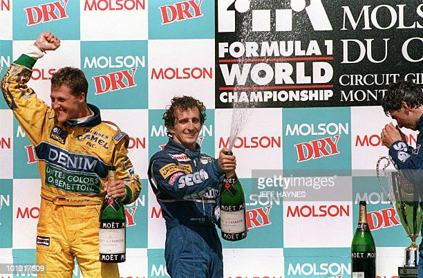 Canadian Grand Prix winner Alain Prost of France and second place finisher Michael Schumacher of Germany celebrate on the winner's podium 13 June...