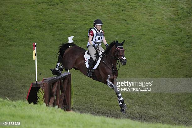 Canadian Hawley BennettAwad rides Gin and Juice on August 30 2014 during the timetable crosscountry test of the 2014 FEI World Equestrian Games at...