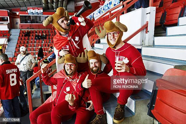 Canadian hockey fans Brock Hutchinson Coady Hines Brent Macsween and Shawn Neily pose prior to the 2016 IIHF World Junior Ice Hockey Championship...