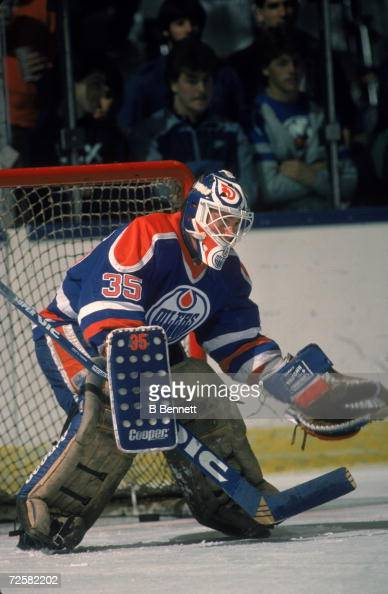 Canadian hockey player Andy Moog goalkeeper for the Edmonton Oilers guards the net during a game April 1986