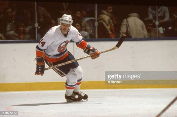 Canadian hockey player Bob Bourne of the New York Islanders skates while he keeps an eye on the action during a home game at Nassau Coliseum...