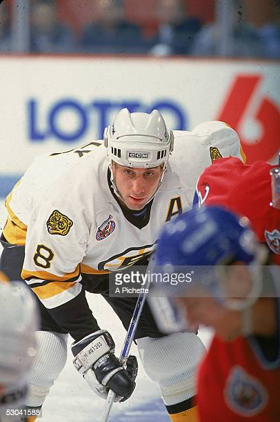 Canadian hockey player Cam Neely of the Boston Bruins keeps an eye on the puck during a faceoff in a game against the Montreal Canadiens at the Forum...