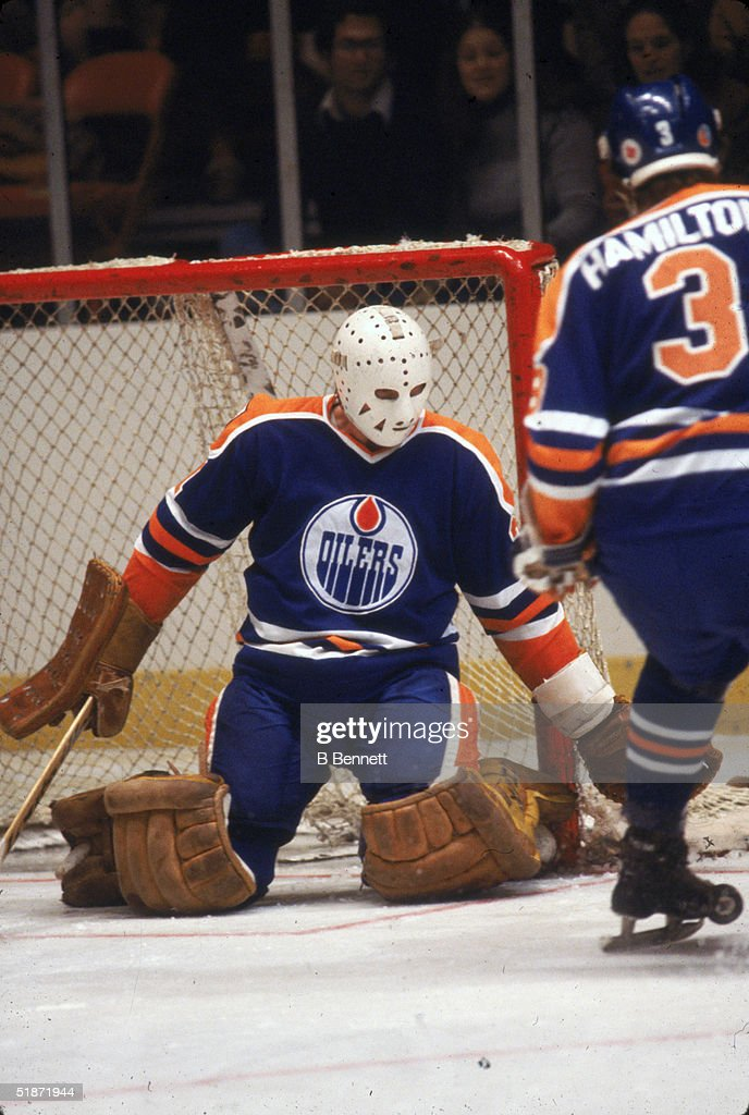 Canadian hockey player Eddie Mio goalkeeper for the Edmonton Oilers keeps an eye on the puck during a game against the New York Rangers at Madison...