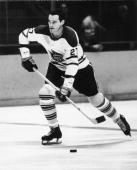 Canadian hockey player Frank Mahovlich of the Toronto Maple Leafs skates up the ice with the puck March 21 1965