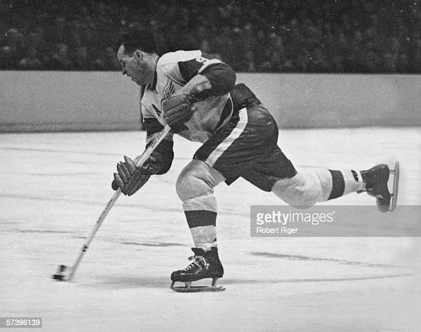 Canadian hockey player Gordie Howe of the Detroit Red Wings fires a shot during a game late 1950s or early 1960s