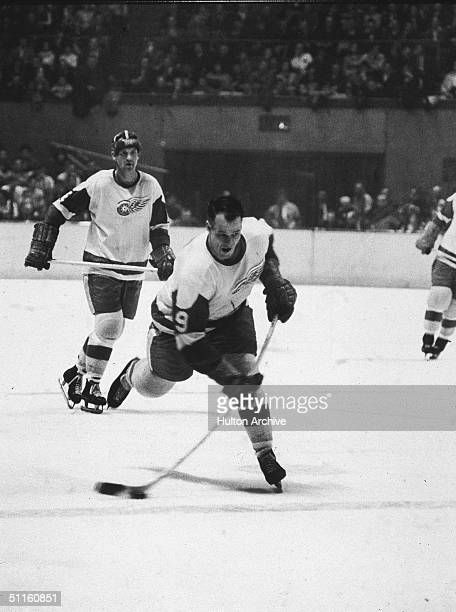 Canadian hockey player Gordie Howe of the Detroit Red Wings winds up a shot during a game with the New York Rangers March 8 1965