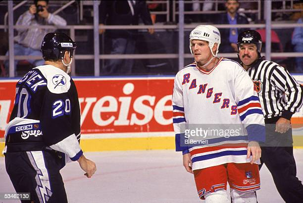 Canadian hockey player Joey Kocur of the New York Rangers exchanges words with Rudy Poeschek of the Tampa Bay Lightning during a game at Madison...