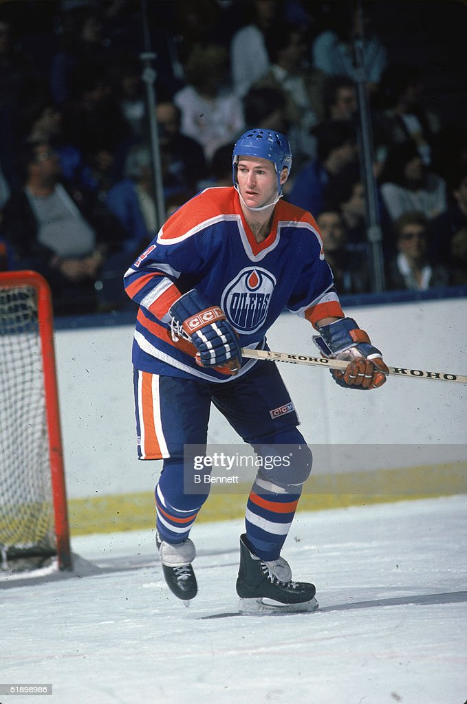 Canadian hockey player Kevin Lowe defenseman for the Edmonton Oilers plays in a road game at Nassau Coliseum Uniondale New York late 1980s