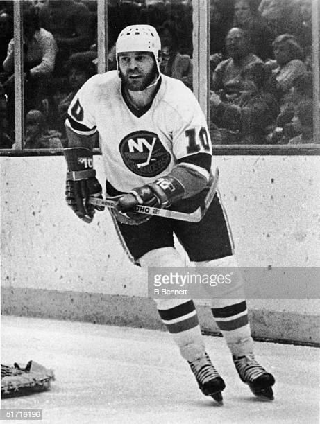 Canadian hockey player Lorne Henning forward for the New York Islanders on the ice during a game at Nassau Coliseum Uniondale Long Island New York...