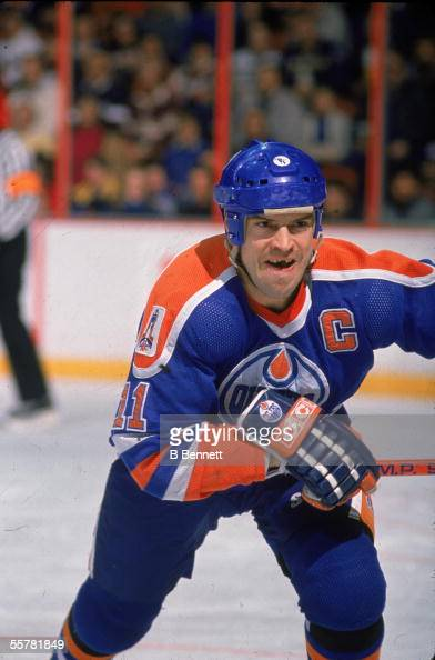 Canadian hockey player Mark Messier of the Edmonton Oilers shows off the gap in his teeth as he skates up the ice during the 1990 91 season