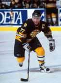 Canadian hockey player Ray Bourque of the Boston Bruins skates up the ice during a road game early 1990s