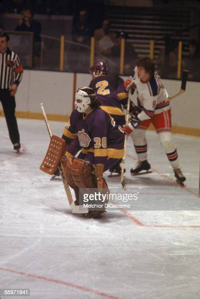 Canadian hockey player Rogatien Vachon goalkeeper for the Los Angeles Kings guards the net while there is some jostling for position behind him 1970s