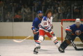 Canadian hockey player Ron Duguay of the New York Rangers in front of the net during a game against the New York Islanders April 1982 Islanders'...