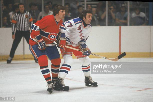 Canadian hockey player Serge Savard of the Montreal Canadiens battles with Phil Esposito of the New York Rangers during a game at Madison Square...