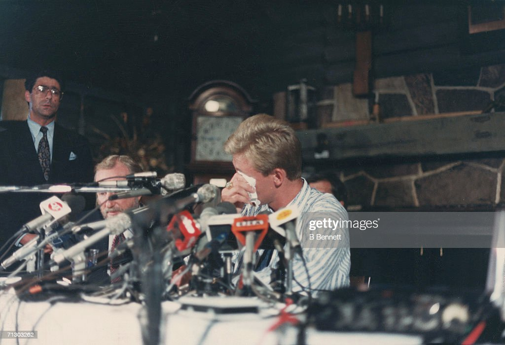 Canadian hockey player Wayne Gretzky sits behind a bank of microphones and dabs away tears at a press conference at the Edmonton's Petroleum Club where it was announced that he had been traded by the Edmonton Oilers to the Los Angeles Kings, Edmonton, Alberta, Canada, August 9, 1988.