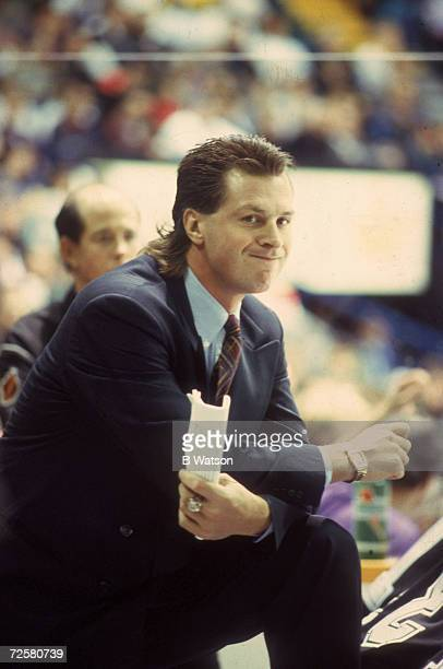 Canadian ice hockey coach Barry Melrose of the Los Angeles Kings gives a wry smile from behind the bench during a game early 1990s