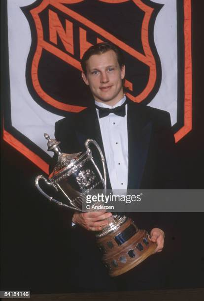 Canadian ice hockey player Adam Graves in front of the National Hockey League logo with the King Clancy Memorial Trophy 1994 The annual award is...