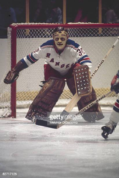 Canadian ice hockey player Gilles Villemure goalkeeper for the New York Rangers guards the net during a game late 1960s or early 1970s
