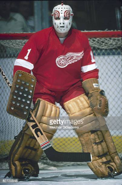 Canadian ice hockey player Jim Rutherford goalkeeper for the Detroit Red Wings gurads the net during a game 1970s