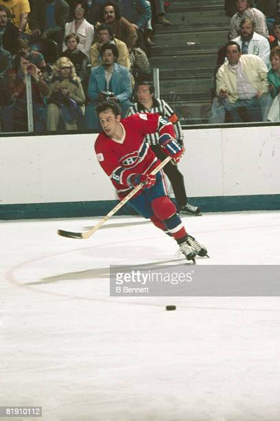 Canadian ice hockey player Jimmy Roberts of the Montreal Canadiens in action on the ice during a home game March 1976