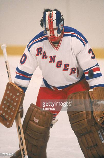 Canadian ice hockey player John Davidson goalkeeper for the New York Rangers guards the net during a game October 1979