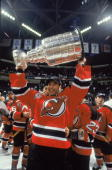 Canadian ice hockey player Martin Brodeur goalkeeper for the New Jersey Devils raises the Stanley Cup in celebration after his teams' victory in the...