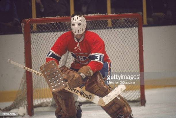 Canadian ice hockey player Michel Larocque goalkeeper for the the Montreal Canadiens guards the net during a game 1970s