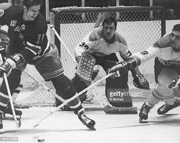 Canadian ice hockey player Rogatien Vachon goalkeeper for the Montreal Canadiens keeps his eyes on the puck in front of his net during a game against...