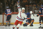 Canadian ice hockey player Ron Greschner of the New York Rangers raises his stick in celebration of a goal during a game against the New York...