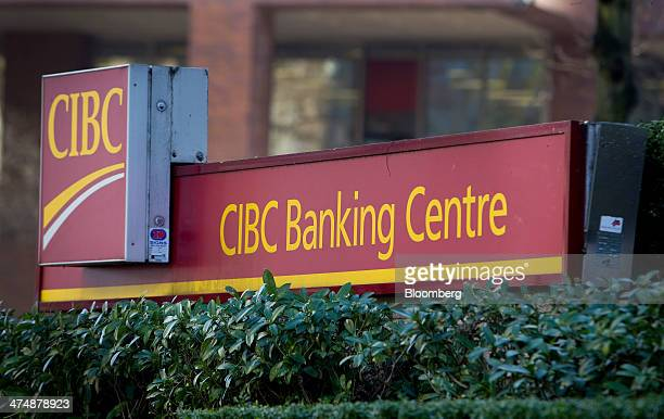 Canadian Imperial Bank of Commerce signage is displayed outside a branch in Vancouver British Columbia Canada on Tuesday Feb 25 2014 Canadian...
