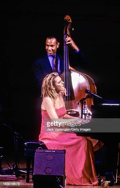 Canadian jazz musician Diana Krall on piano leads her quartet which includes John Clayton on upright acoustic bass during a JVC Jazz Festival concert...