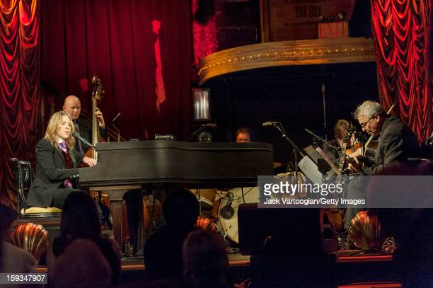 Canadian jazz musician Diana Krall plays piano with her quartet at the Box New York New York September 24 2012 Also pictured are bassist Dennis...